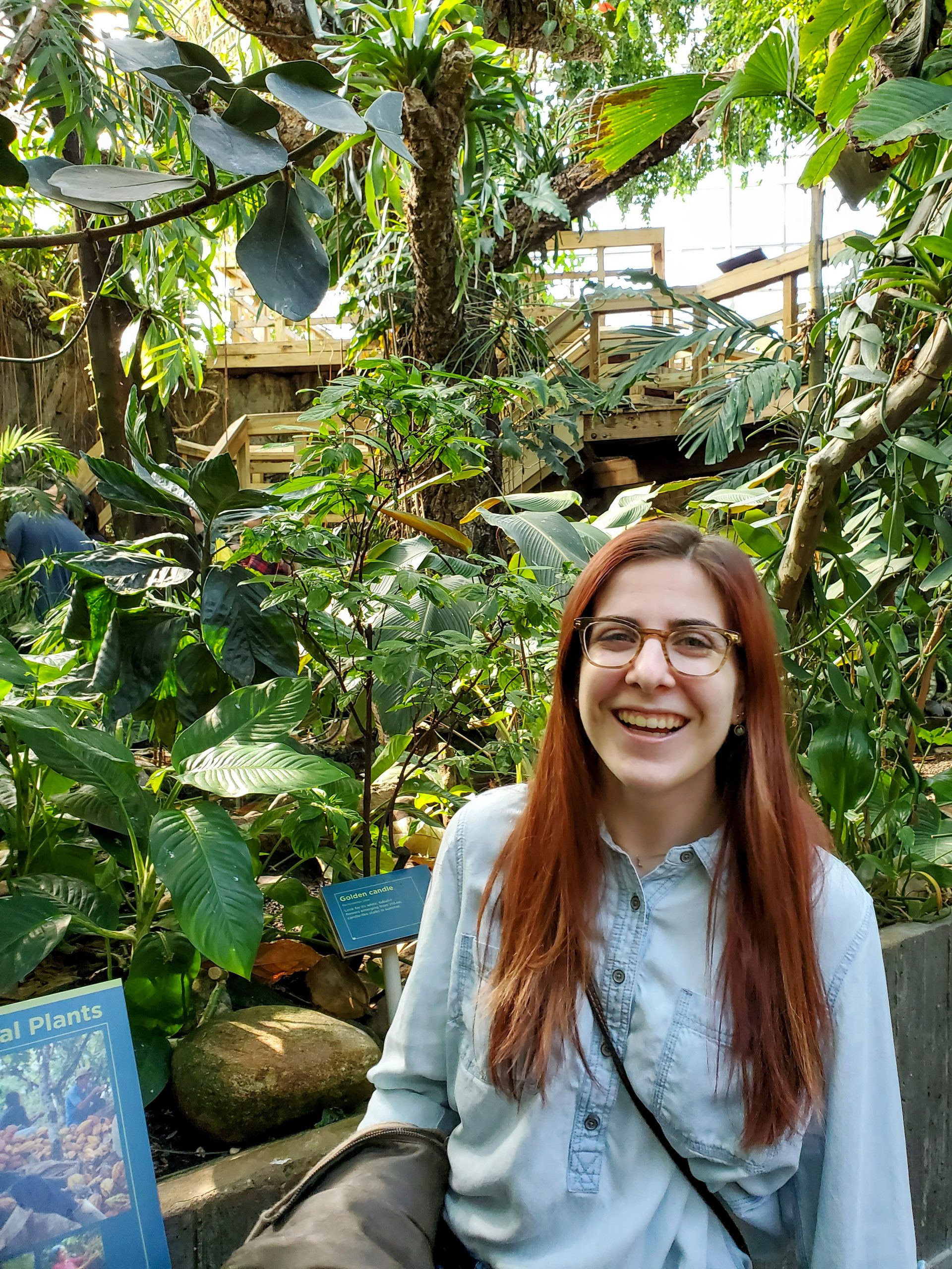 Picture of me with a LOT of plants behind me
