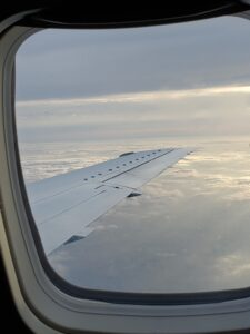 layers of clouds and plane wing outside window